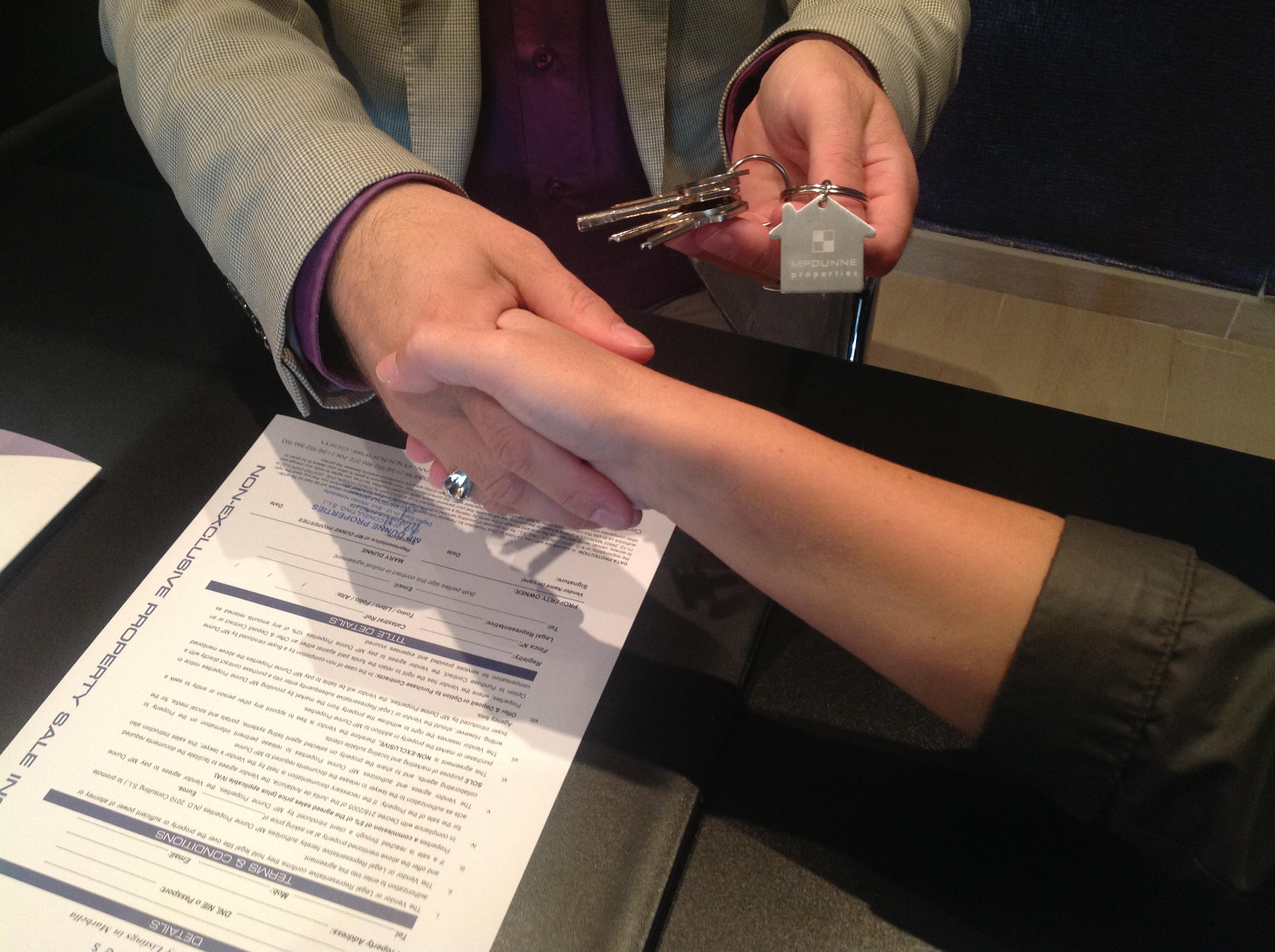 Shaking hands over buying real estate property with MP Dunne Properties Marbella